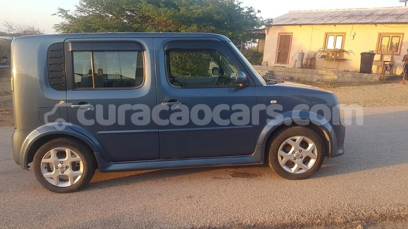 Big with watermark nissan cube curacao barber 3869